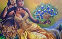 Oshun goddess in yellow dress