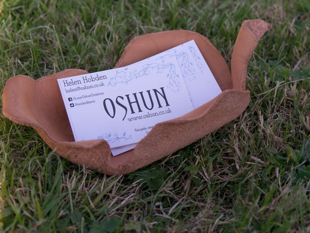 Using a leather leaf bowl as a business card holder.