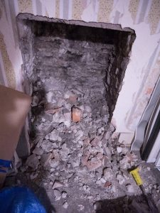 A small bit of rubble - exposing a fireplace