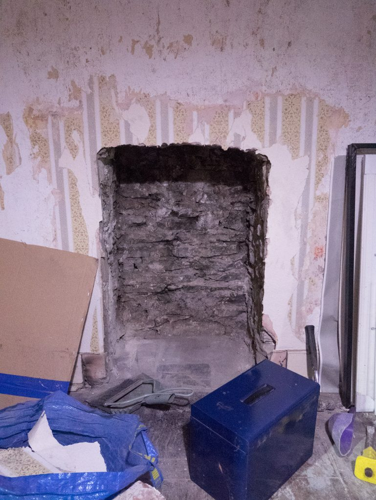 Finished exposing the fireplace.