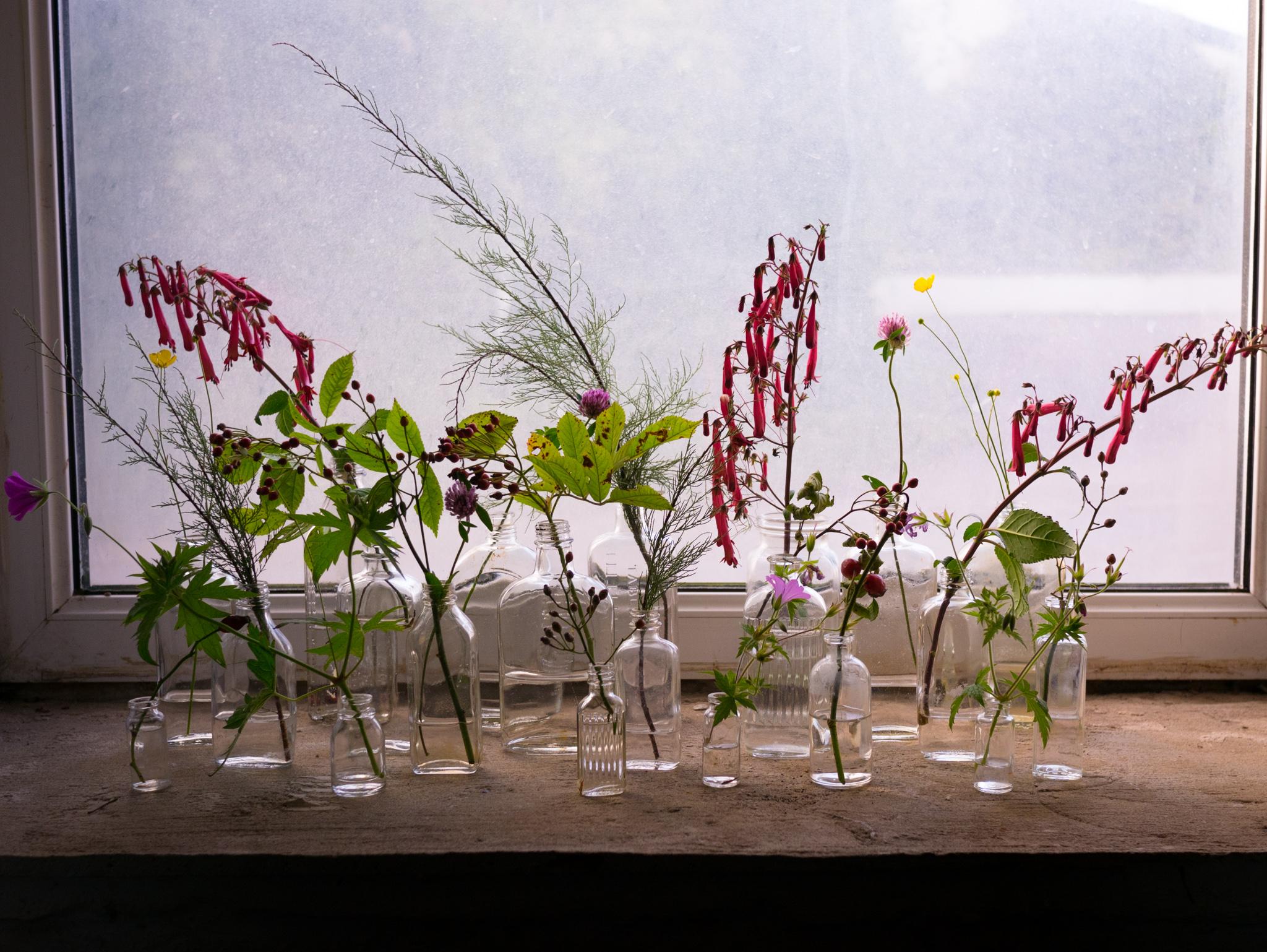 Making a floral display with vintage bottles