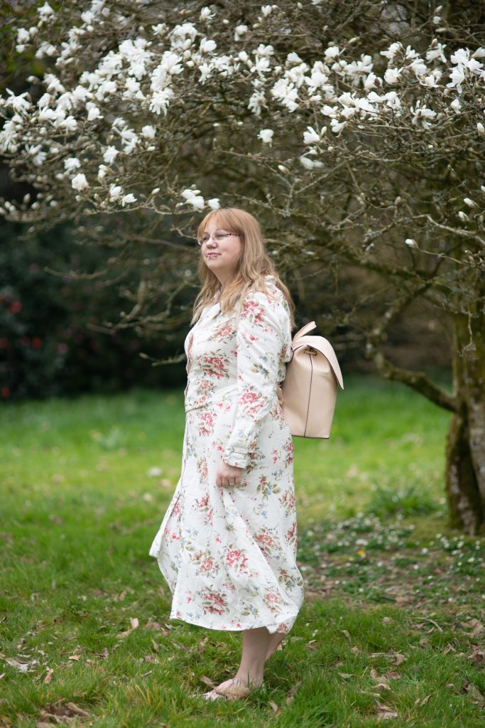 30 plus style blogger wearing a Primark dress and rucksack