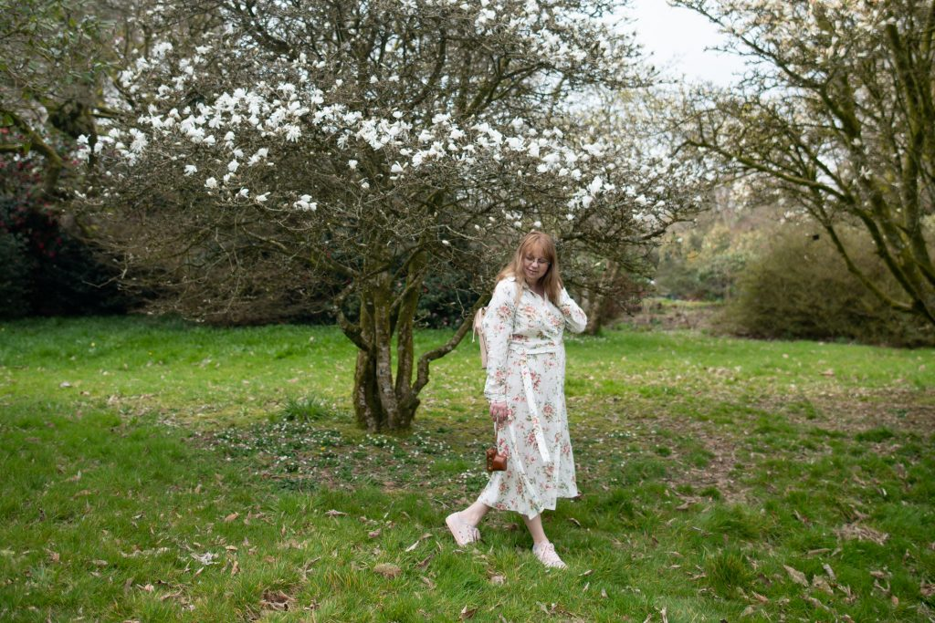 Age forty fashion blogger wearing a floral button dress