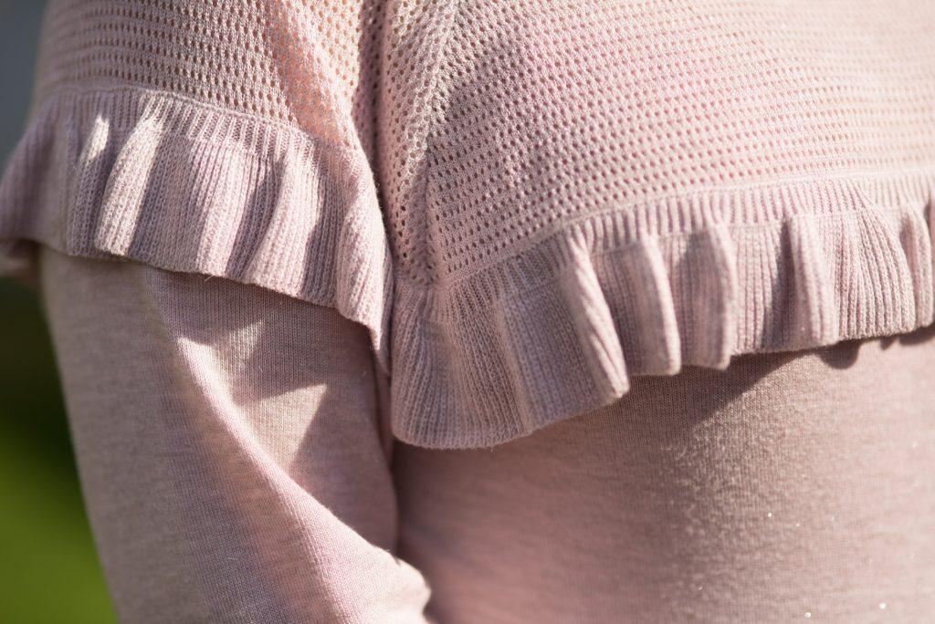 ruffles on a blush pink top