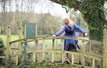 age 40 fashion blogger leaning on bridge wearing a pixie jacket