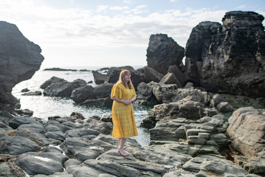 40 plus style blogger wearing the perfect yellow dress