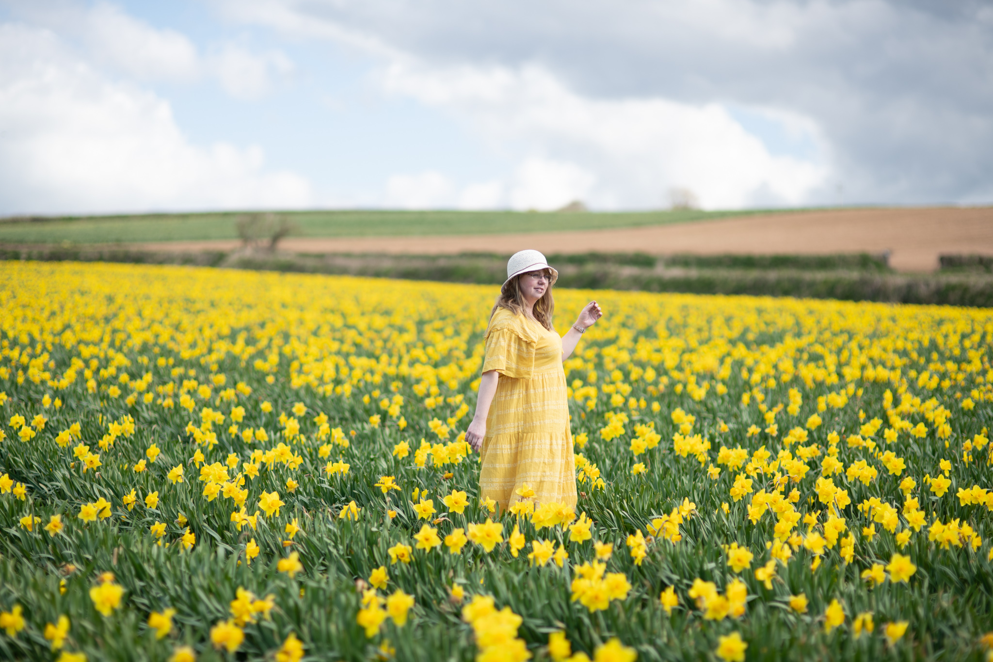 Over 30 style blogger wearing a yellow m&s dress