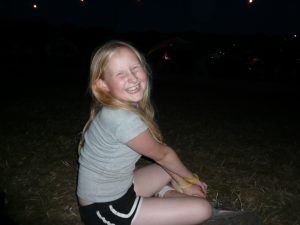 sitting on the grass at night at Glastonbury festival