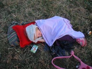 baby asleep on the grass at Glastonbury Festival