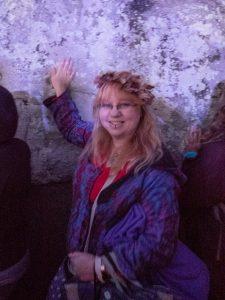 lifestyle blogger touching the stones at stonehenge