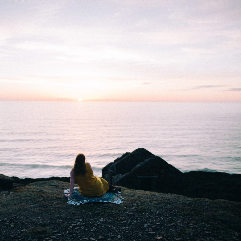 lifestyle blogger watching sunset in Cornwall