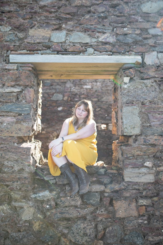 UK fashion blogger styling a mustard yellow dress
