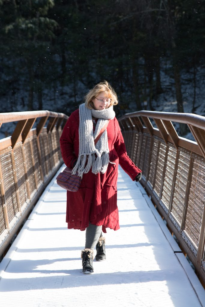 30 plus fashion blogger styling a red coat