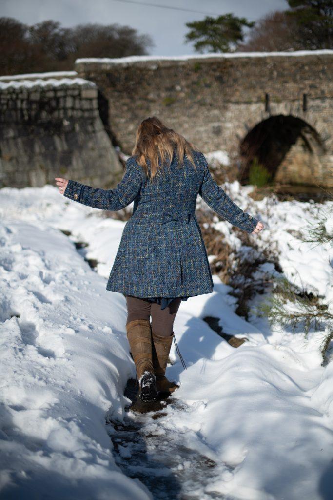 Plus size fashion blogger over 40 styling blue coat