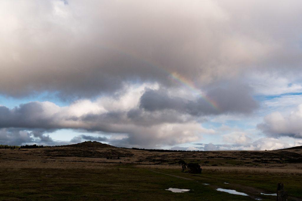 Dartmoor in winter with a rainbow