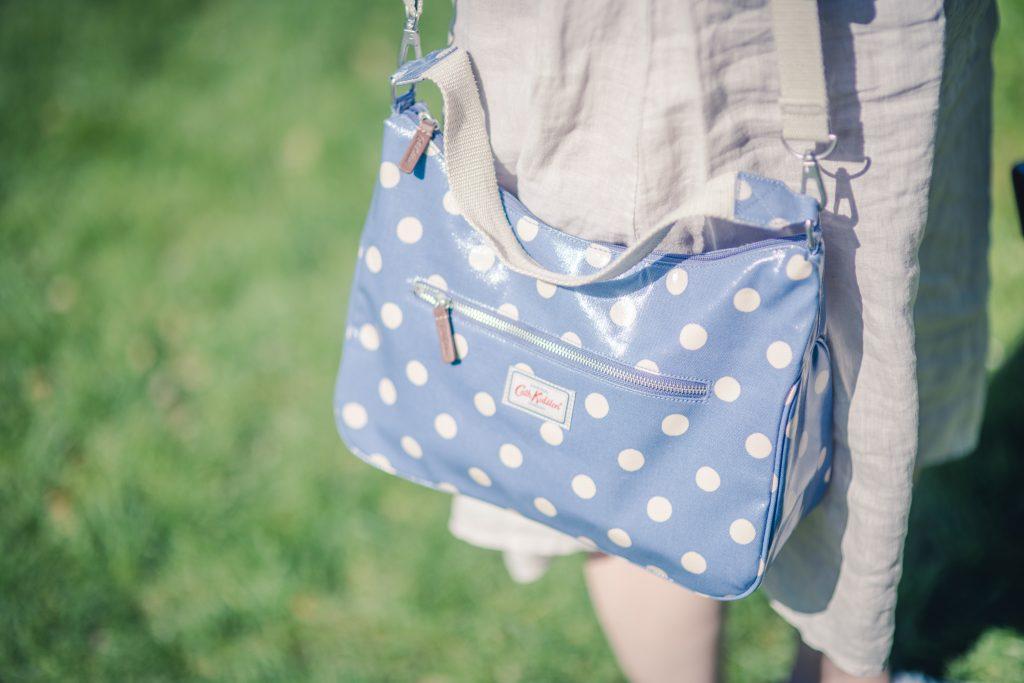 wearing Cath Kidston seafoam blue button spot oilcloth cross body bag